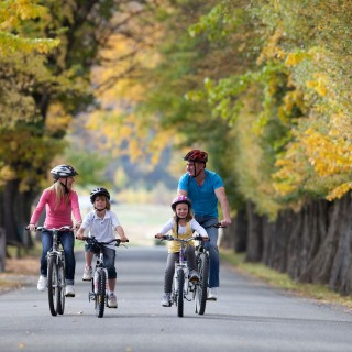 Family biking in autumn